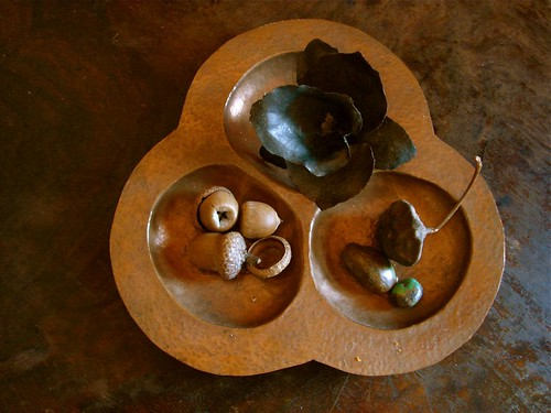 derek's hand hammered copper orchid in an old copper piece by denise carbonell