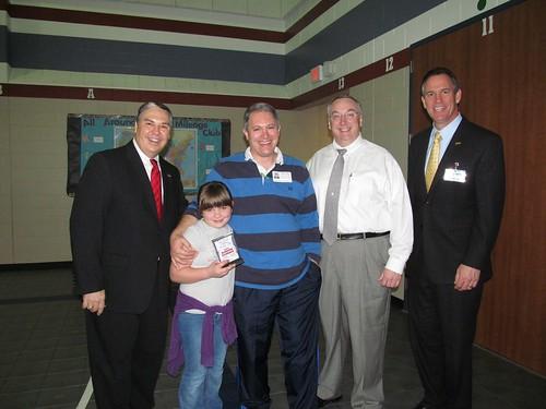 Madie Receives Award by Pastor Lake