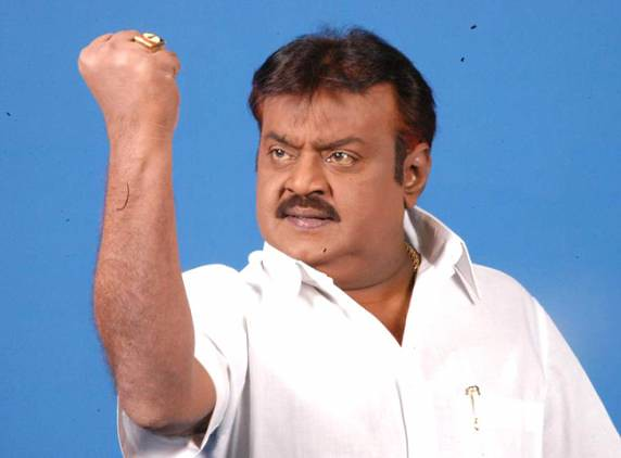 Vijayakanth striking a macho-man pose