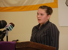Kaytie Scully delivers remarks at a podium during the release of Maine's strategic education plan.