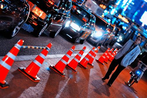 Taxis, Cones, and a Man -- Shinjuku, Tokyo by hidesax