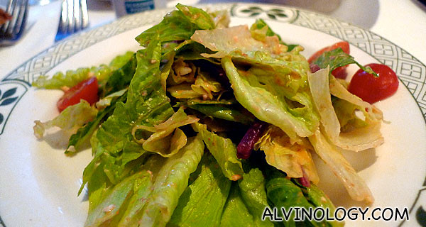 Romaine and iceberg lettuce, watercress, shredded beets, chopped eggs and croutons