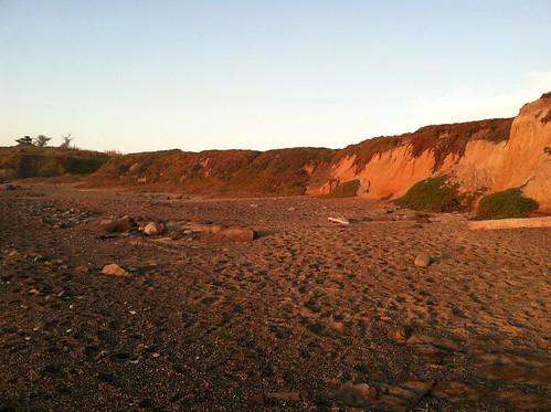 Oranges pebble beach at sunset