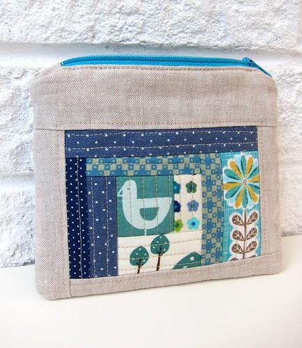 Sunny blue bird pouch