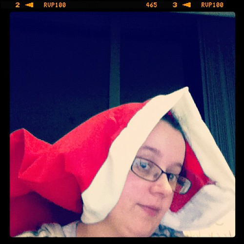 My manager was sent an oversize Santa hat. This is the only way to wear it and see what you're doing. Otherwise it comes down to your shoulders!!