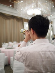 Necking a bottle of sake after a wedding dinner