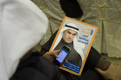 Man using iPhone during Kuwait election 2012