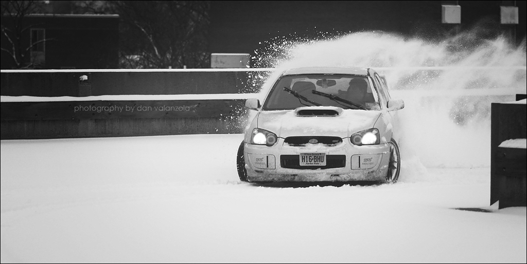 Subaru STi drifting in the snow