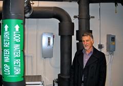 Paul Caron stands in front of a geothermal heating/cooling system at Harriet Beecher Stowe Elementary School in Brunswick.