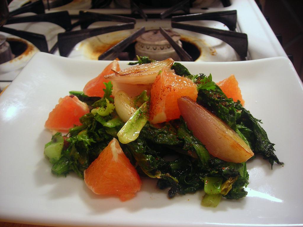 Warm chicory salad, with shallots, Kalamata olives and blood orange