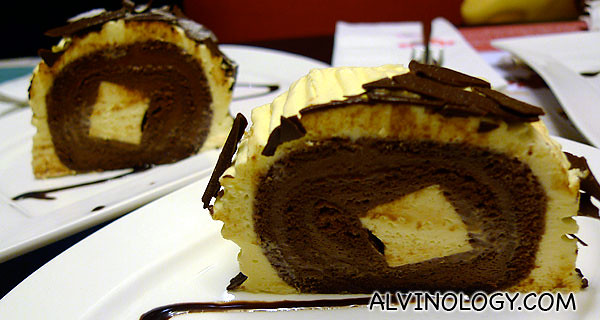 Two slices of cheese and chocolate log cake