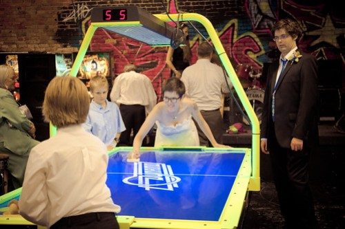Tyler and Maddy play air hockey