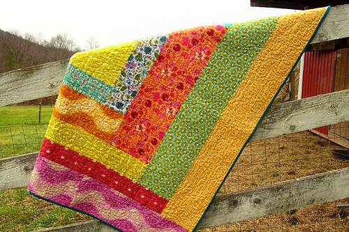 Folksy Flannel quilt on the fence