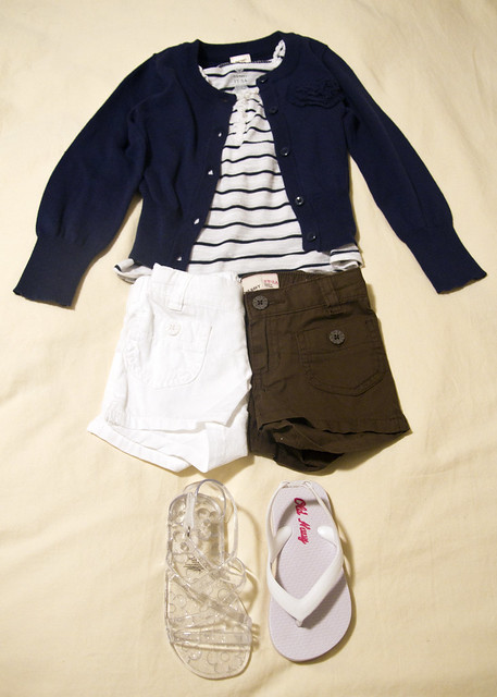 blue and white striped tank top, blue cardigan, white or brown shorts, clear gladiator sandals or white flip flops