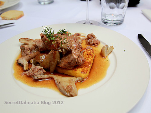 Lamb confit served on forest mushrooms and polenta