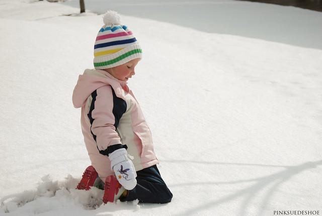 kneeling in snow