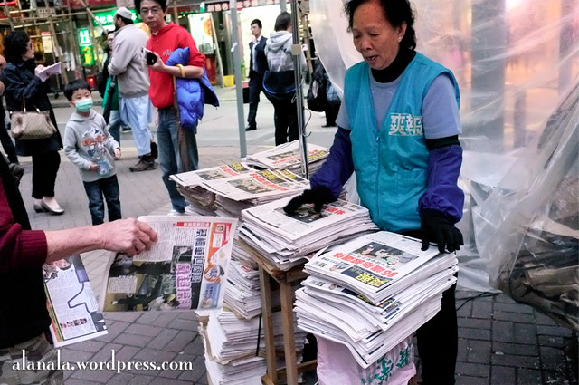 Paper being distributed like a news stand.