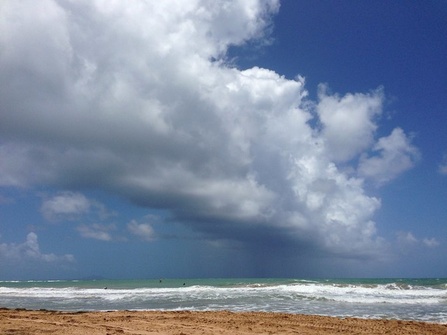 The rain in Humacao stays mainly in the beach.  Do not be fooled by the bright blue sky!