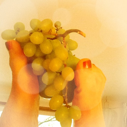 Eating my grapes from a footed fruit bowl.