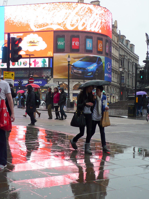 Piccadilly Circus couple puddle