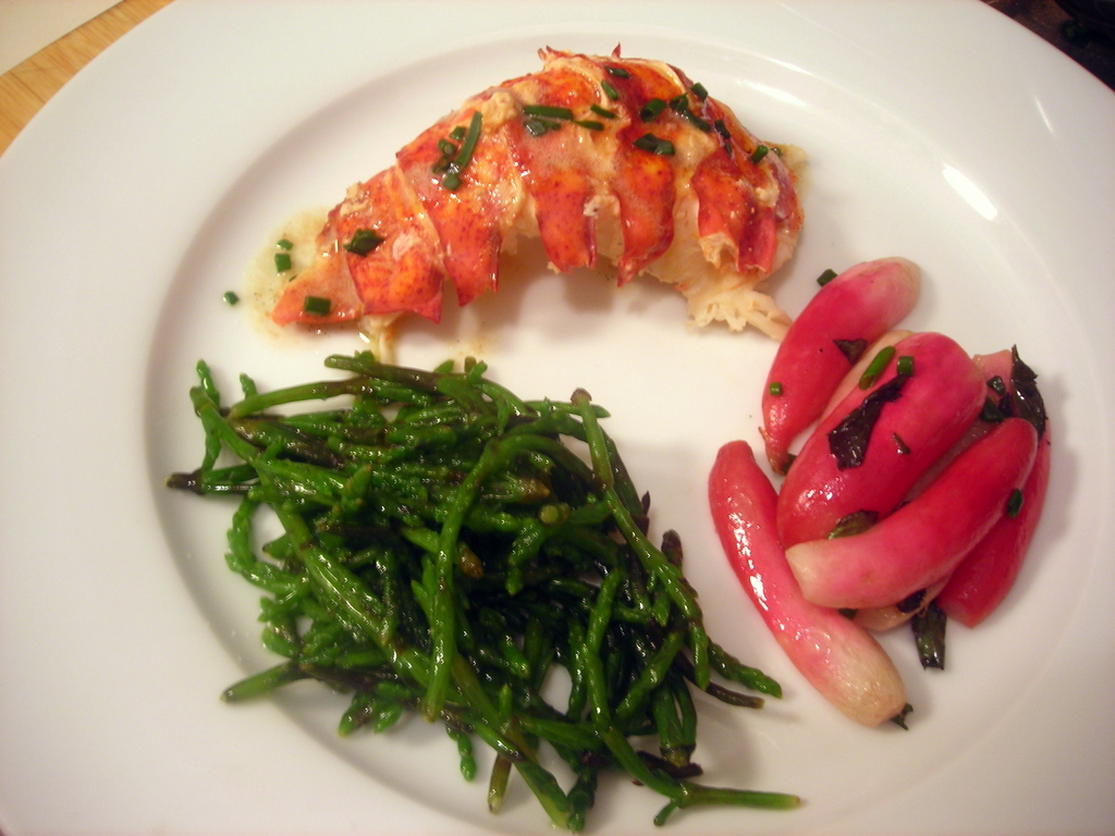 Lobster with vanilla-lobster butter, butter-poached French breakfast radishes with mint, sautéed samphire