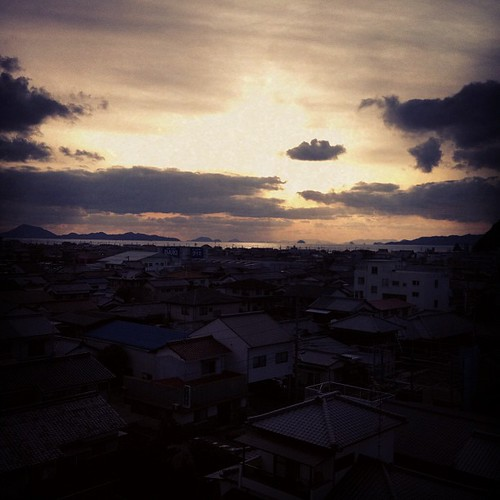 the sun setting over japan