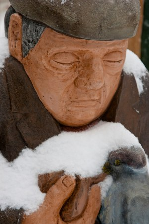Saint John : John Hooper Statue - Man with bird in Snow