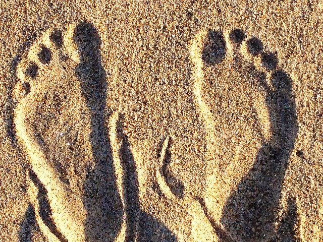 Sink your toes into the sand. Yeah. Like that.