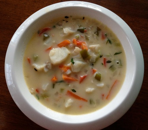 A bowl of fresh fish chowder with white beans