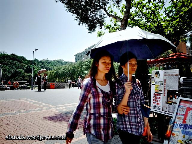 Sisters in the umbrella