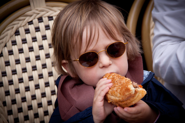 French Kid Eating a Big Burger at Le Progrés - Montmartre, Paris