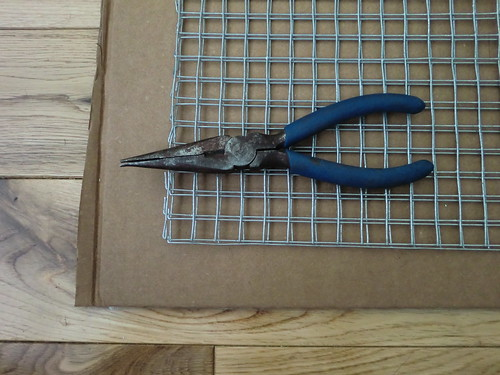 Needle-nose pliers to turn down sharp edges