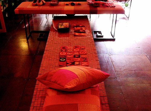 orange mosiac table & patchwork bench by denise carbonell