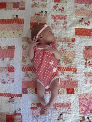 My gorgeous Niece with her new quilt