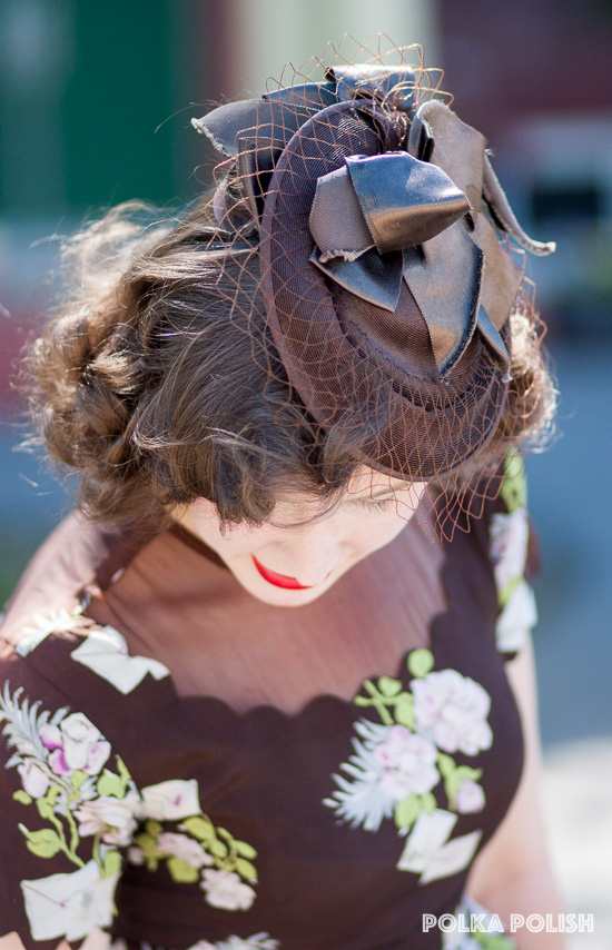 A brown tilt hat with a cascade of satin ribbons and a very stiff veil is perfect for breakfasting.