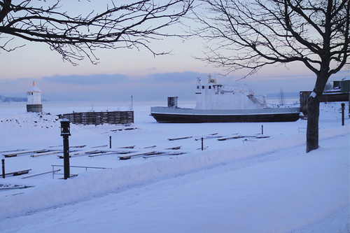 Boat Docked on Frozen Lake Mjøsa by drobi_123