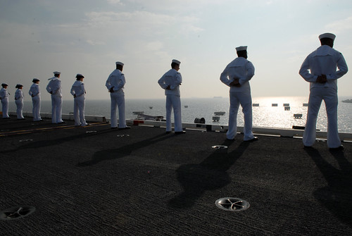 Sailors man the rails of USS George Washington. by Official U.S. Navy Imagery