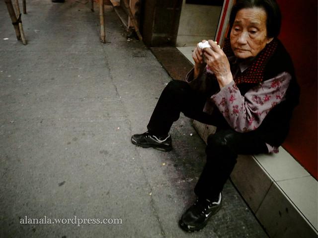 Lady resting on roadside
