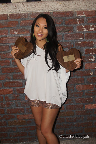 Asa Akira showing off her performer of the year and superslut awards