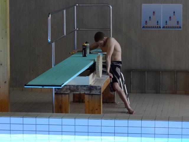 Pál doing homework between prelim heats