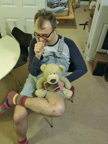 Davy in shortalls with Buzzle the bear. This is how I went dressed to a New Year party.