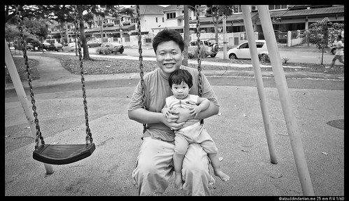 Daddy and Mia sitting in the swing