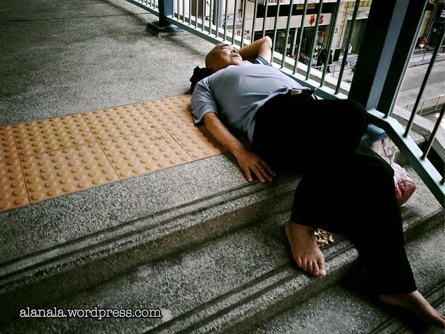 Man napping on the bridge