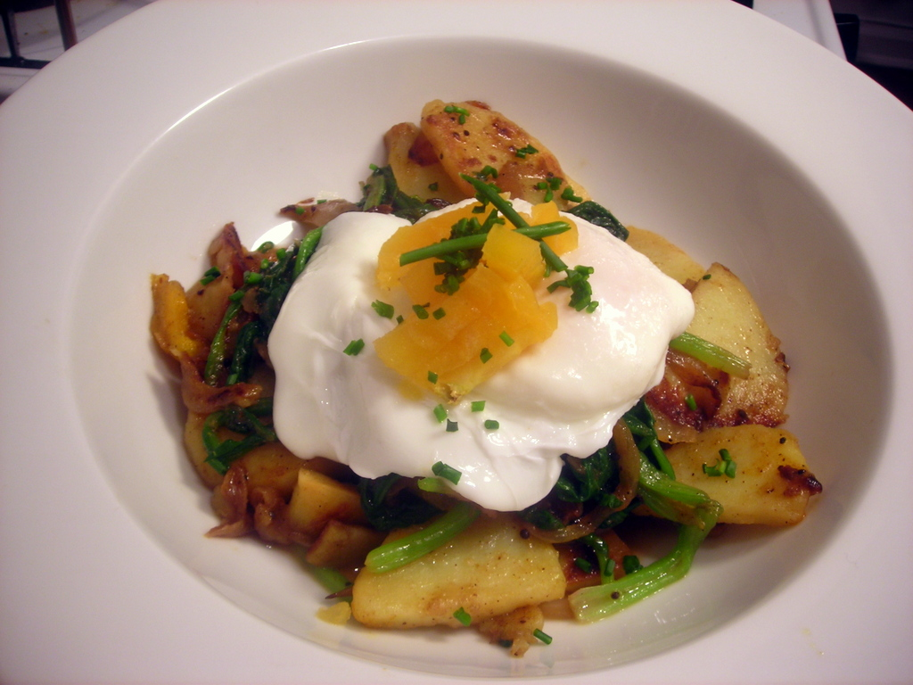 Poached wild turkey egg, with cumin-spiced potatoes, spinach and heirloom tomatoes