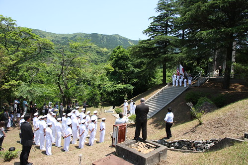 Sailors stand in formation during a Memorial Day ceremony at the site of the Soto Dam and prisoner of war camp. by Official U.S. Navy Imagery
