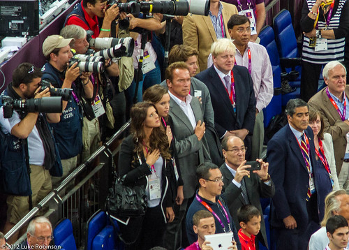Arnold Schwarzenegger stands for the US national anthem while Boris Johnson looks on, USA Spain Olympic Basketball Final, August 12th 2012