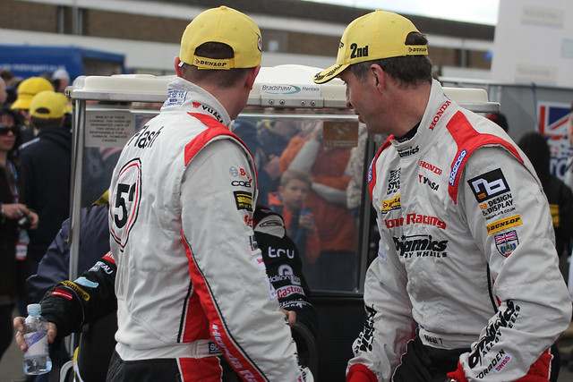 Gordon Sheddon, Matt Neal and Mat Jackson, top three  at the BTCC race at Donington Park in April 2012, arrive at the podium