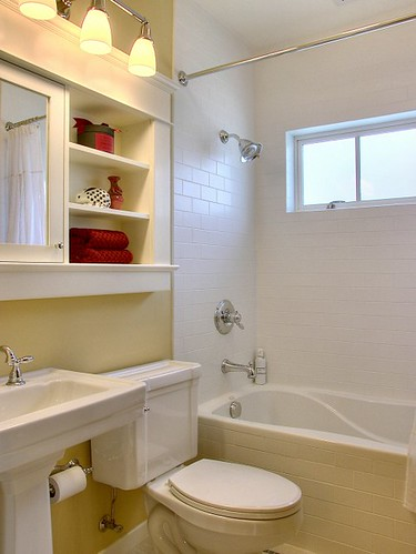 Innovative-Ideas-for-Creating-Storage-in-a-Compact-Bathroom-mirrored-cabinet-and-open-shelving