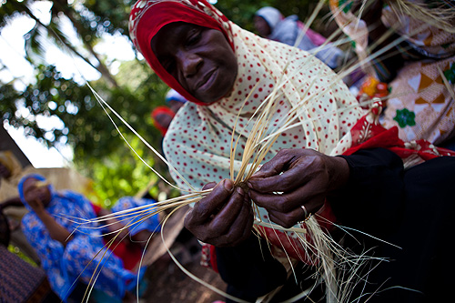 Members of the UWAMWIMA association also make baskets to sell a