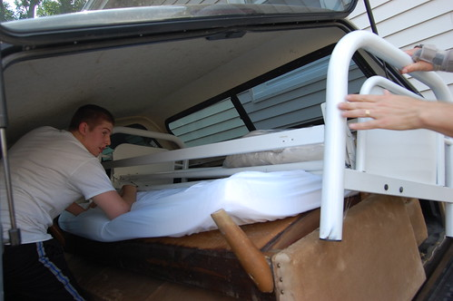 Aaron in truck helping pull in frame of futon